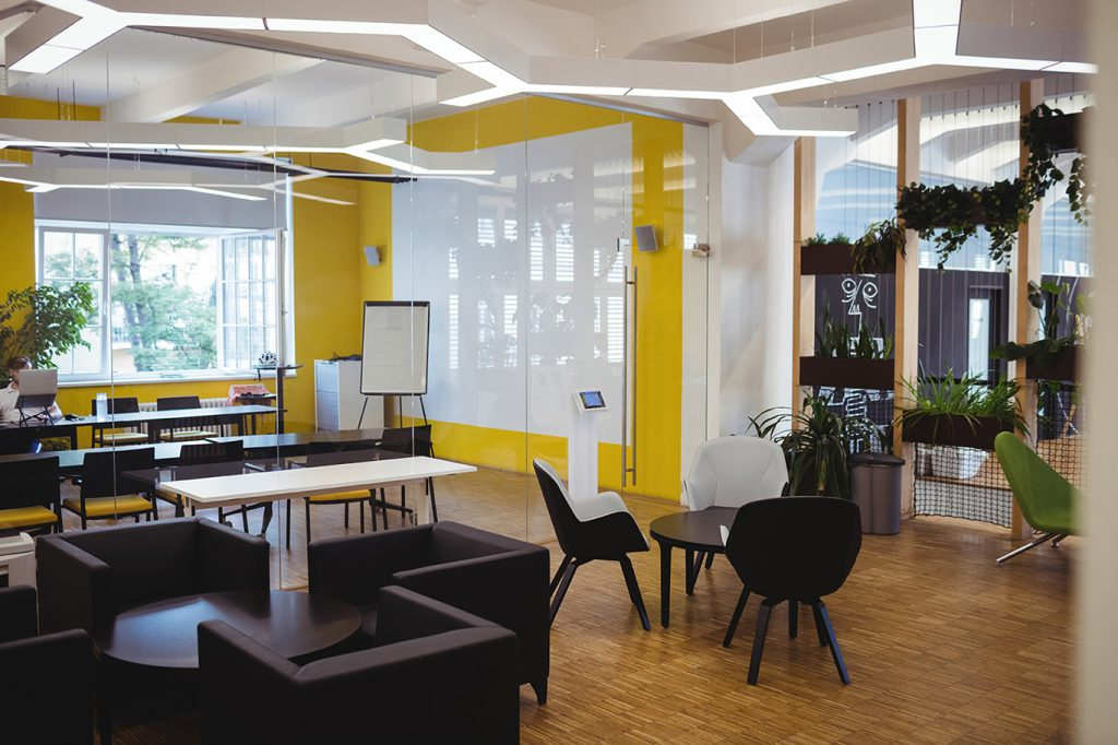 fancy office design concept yellow wall, black chairs, glass wall, modern concept